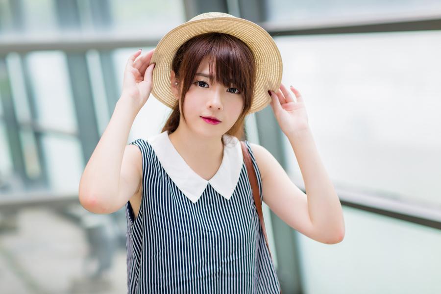 フリー 写真麦わら帽子を被る台湾の女性