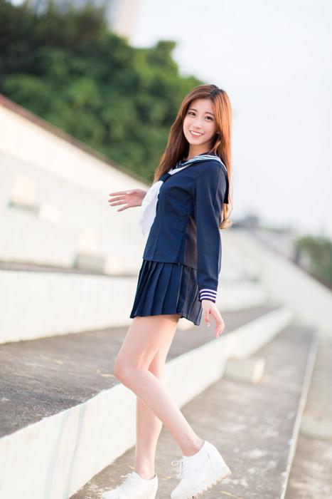 フリー写真 セーラー服姿で観客スタンドに立つ女子高生