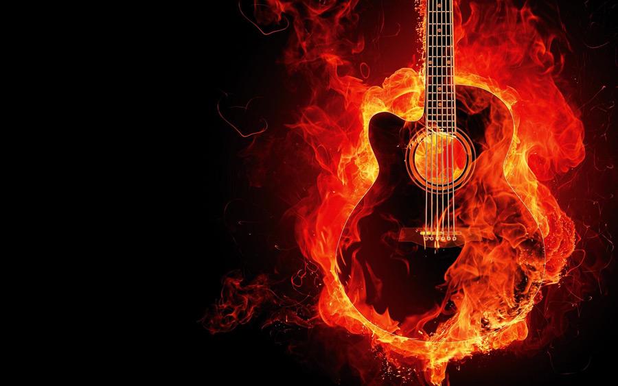 フリー写真 アコースティックギターと燃え盛る炎
