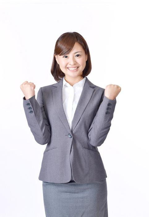 フリー写真 ガッツポーズの日本人のビジネスウーマン