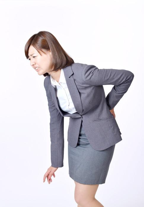 フリー写真 腰痛の日本人の女性社員