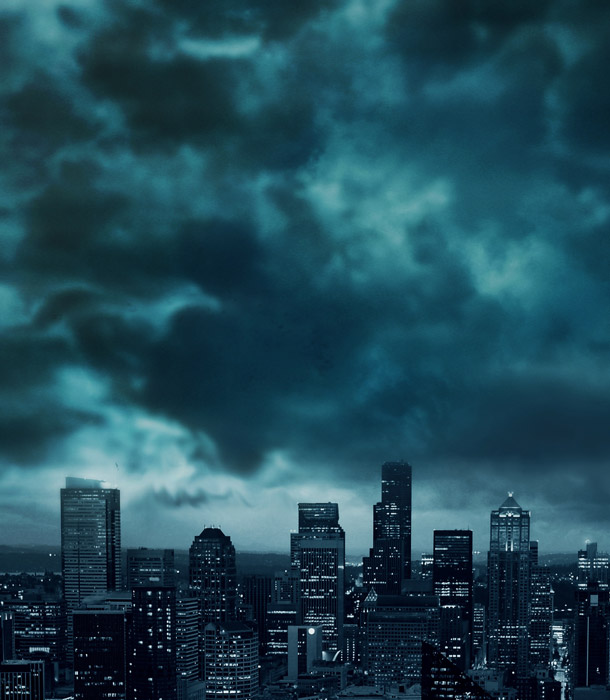 フリー写真 暗雲と都市の街並み