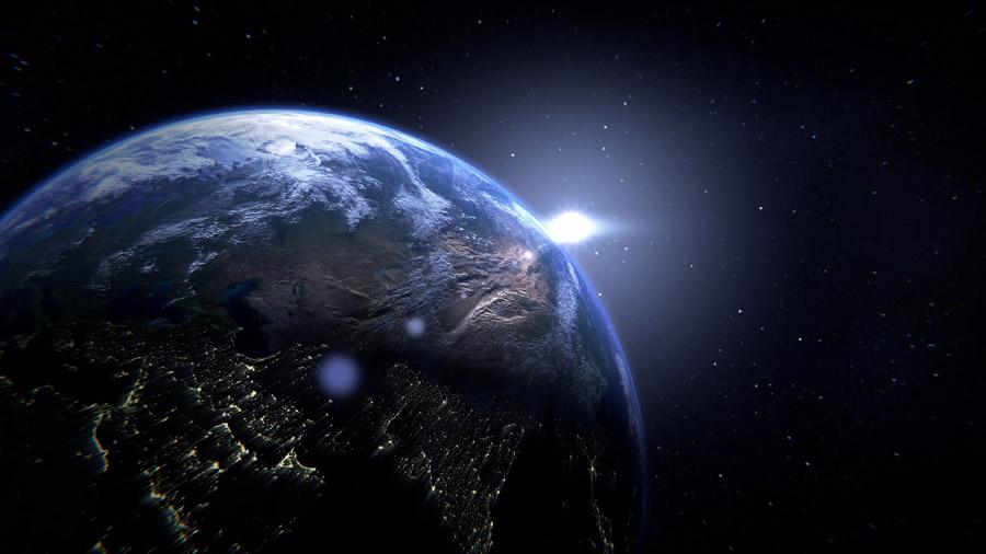 フリーイラスト 宇宙に浮かぶ地球と太陽の光