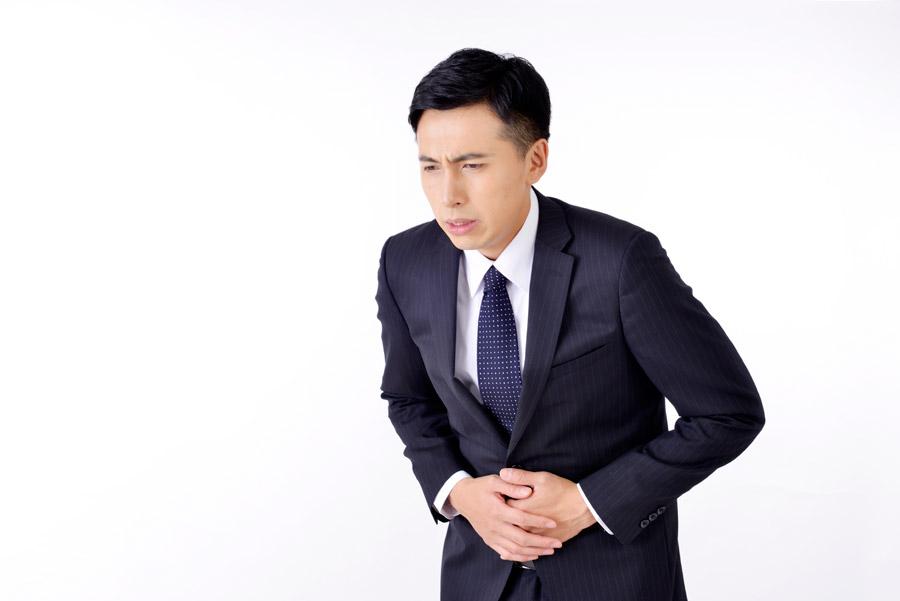 フリー写真 お腹が痛い日本のビジネスマン